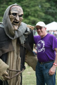 Costume monster posing with a man at a Renaissance Festival.