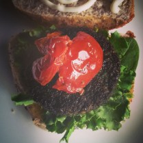 Veggie burger - lentil, kale and green garlic patty with lettuce, sun dried tomatoes and mayonnaise