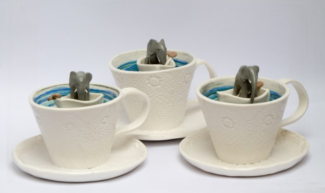 Elephants in boats, in teacups. Sculpture