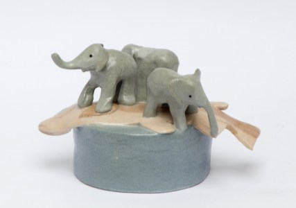 Progressive Alliance - three baby ceramic stoneware elephants standing on a trout.