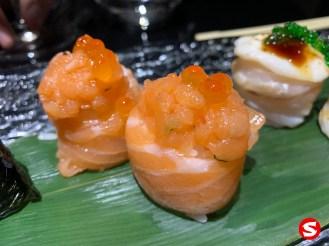 sake (salmon) maki (roll) with ikura (salmon roe)