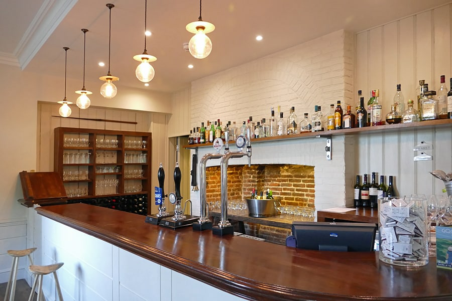 The bar at The Goodwood Hotel, nr Chichester, West Sussex, England