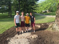 These young men did a lot of work preparing the rain garden.
