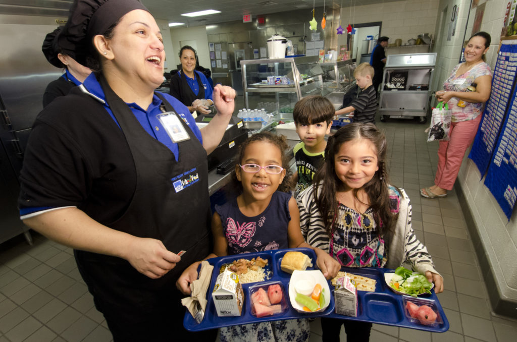 Kids with healthy farm to school lunches. Photo credit: USDA.