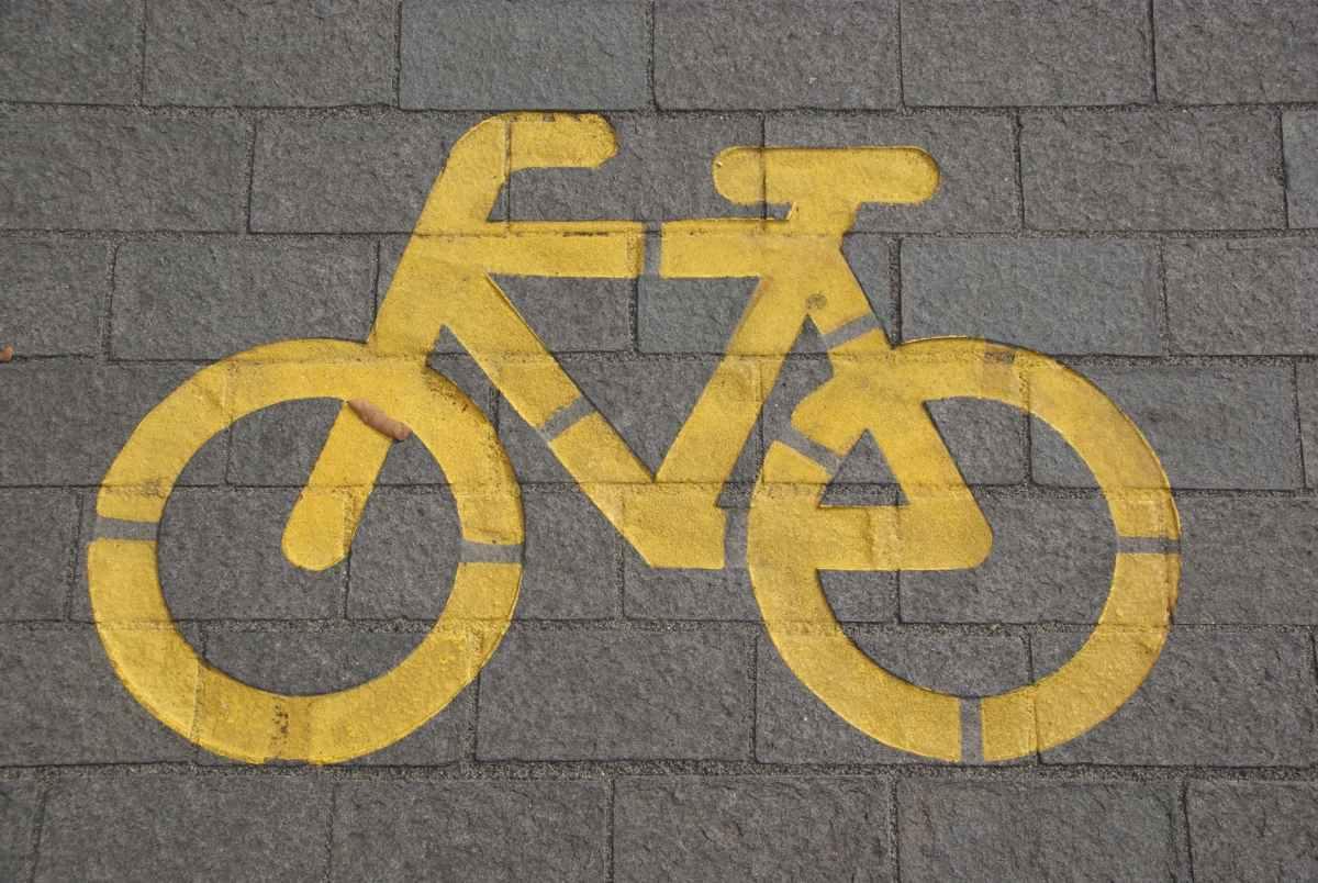 bicycle lane on gray concrete road