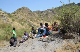 Geology students from Glasgow and Tanzania students in a volcanic crater in the rift flank of the Lake Natron rift