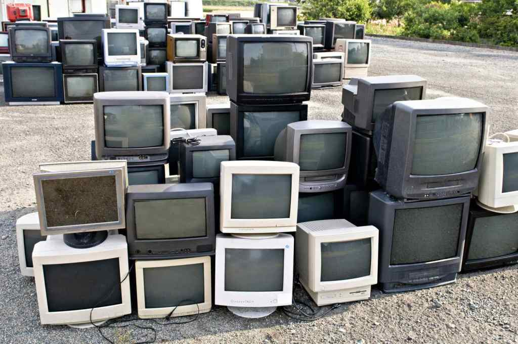Pile of tvs for recycling electronics