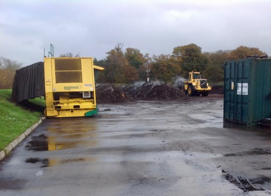 Diggers turning compost