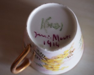 Bottom of tea cup, Crown imprint, painted on words: Jenni Moore 1914