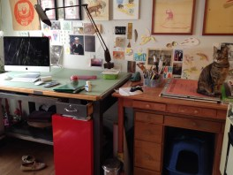Taylor's work area—or studio—within her apartment, watched over by the ever-present Hazel, who often lies on the drafting table or sits on her lap while she works.