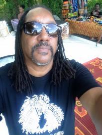 Afro Bohemian Snob founder Kevin Walker sun bathes in the Susu Village