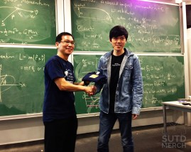 Cohort class Chairman gets presented his T-shirt.