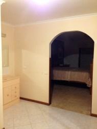vanity unit with bedroom behind