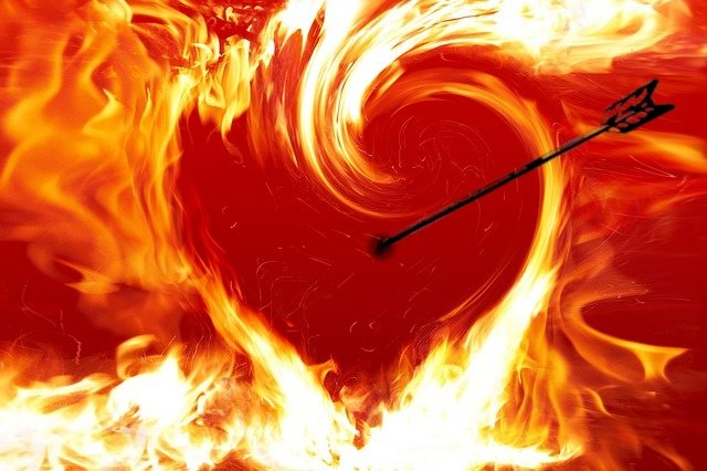 picutre of heart on fire with dart piercing it
