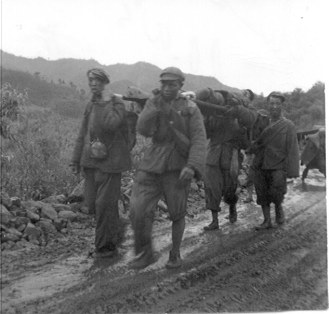 Chinese Prisoners carrying their wounded