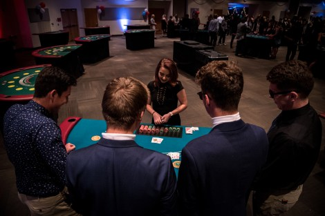 Students and the dealer competing at Casino Night. Photo by photojournalist, Zihao Li.