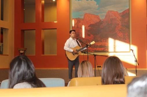 Hayden Carroll SUUSA President performs at Open Mic Night. Photo courtesy of photo journalist Robin Nelson.