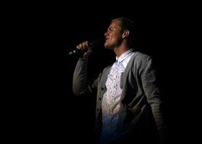 Dallin Tripp singing at Mr. SUU. Photo By Samantha Burfiend.