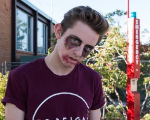 Chris Dimond providing runners with the zombie dead stare while shambling past the SUU Sharwan Smith Student Center. Photo courtesy of photo journalist Morgan Barton.