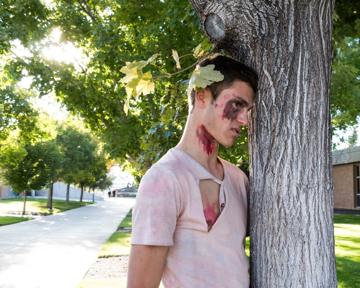 Undead walker Thomas Grant take some time to enjoy one of the trees on the campus of SUU. Photo courtesy of photo journalist Morgan Barton.