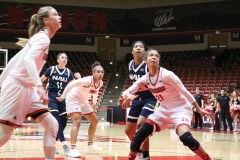 Sisters Whitney and Kiana Johnson play together against NAU on Feb. 10 in the America First Event Center.