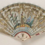 Folding fan of ivory sticks with a silk leaf embroidered with sequins and painted with a female figure watering plants. English, circa 1810. Fan Museum, Greenwich.