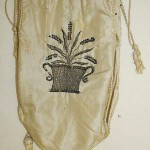 Simple and elegant reticule with lavender embroidered on one side and the lady's initial on the other surrounded by flowers, 1800-10 Metropolitan Museum of Art.
