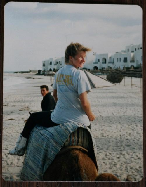 Suzanne Carillo riding a camel Tunisia 1987