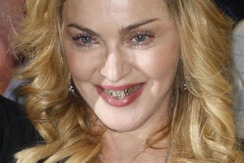 Madonna-shows-her-grills-as-she-leaves-the-new-Hard-Candy-Fitness-centre