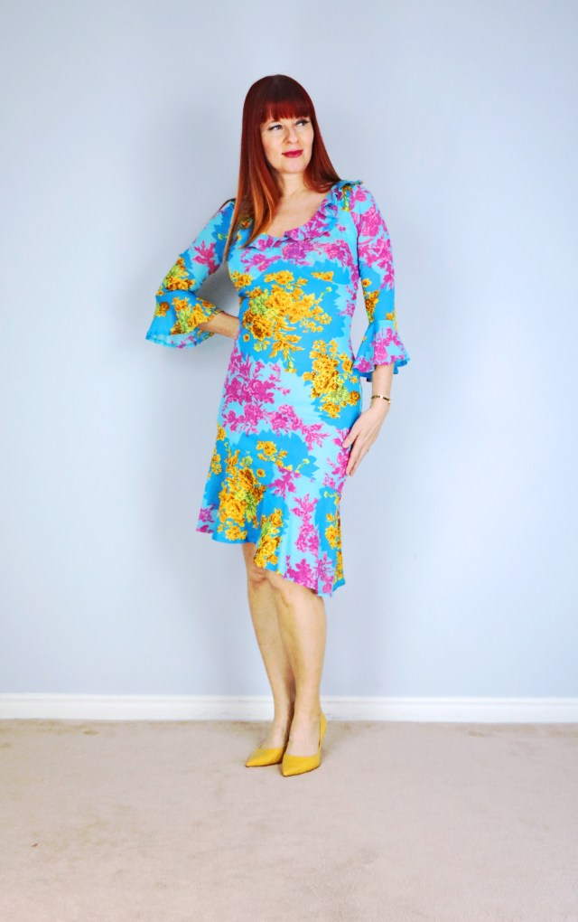 challenge your style try something new vintage flutter sleeve floral spring dress suzanne carillo