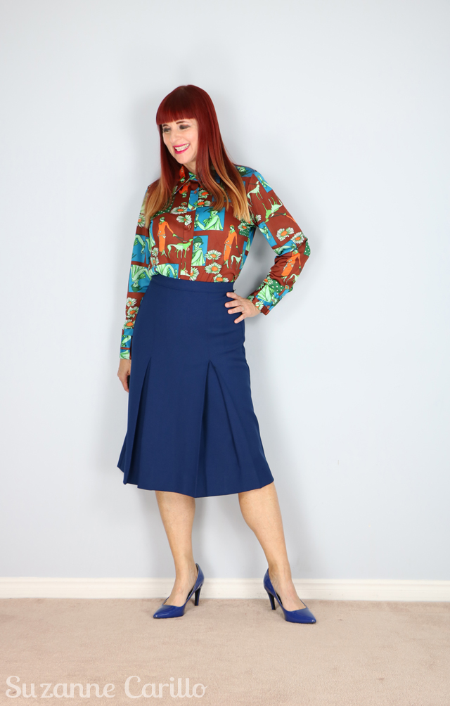 novelty print blouse blue pleated skirt suzanne carillo