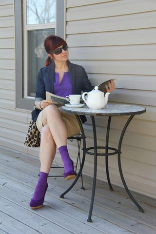 Purple shirt tan skirt jacket paper