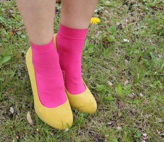 Yellow pumps pink socks