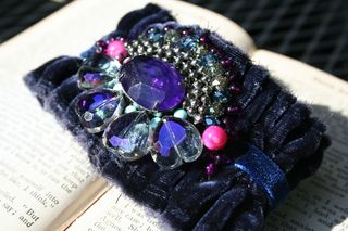 Blue velvet cuff on book front