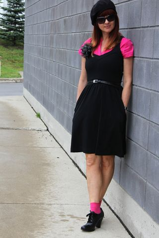 Black dress pink shirt pink socks beret