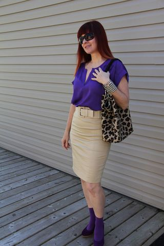 Purple shirt tan skirt side