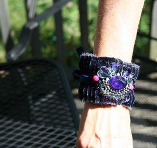 Blue cuff on arm
