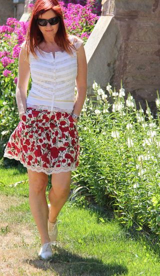 Red anthropologie skirt white blouse walking