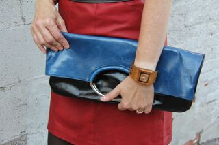 Blue leather clutch with metal handle