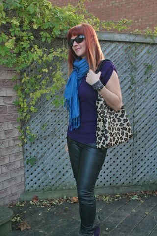 Purple sweater blue scarf