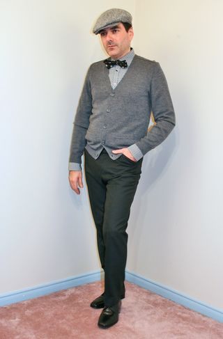 Black pants grey sweater black bow tie