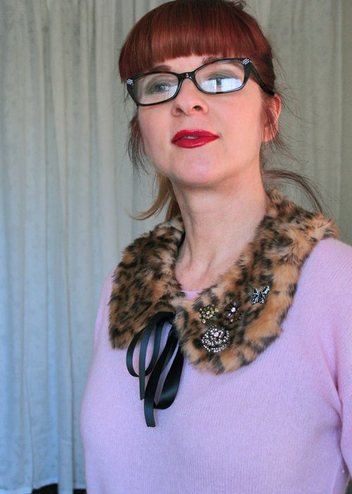 Vintage brooches on leopard collar