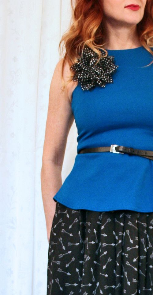 Blue peplum black fabric flower