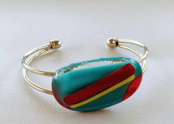 Turquoise glass bracelet with a dash of red and yellow on a silvered bangle