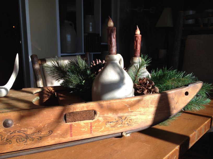 I love this old sled, enough to place it on the dining room table as a centerpiece