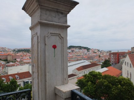 The Lisbon skyline, and a small reminder of the Carnation revolution.