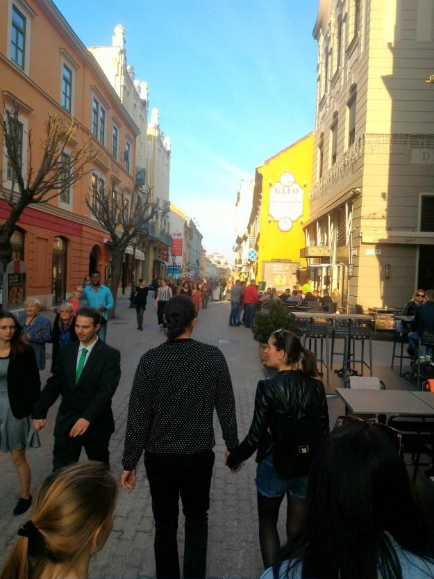 Sári and her boyfriend walking in Pécs