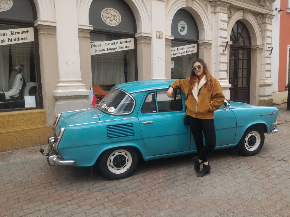 Maddie with a Trabant (communist car) in Pécs