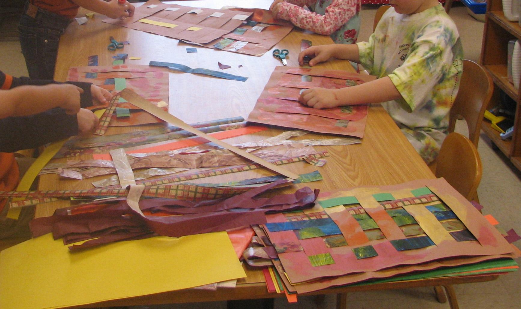 Kids weaving Thanksgiving placemats