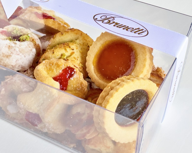 Brunetti mixed biscuits in clear Perspex box on white background